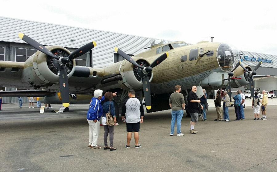 People admire the B-24 Wings of Freedom plane. — Photo by Jim Collins ©