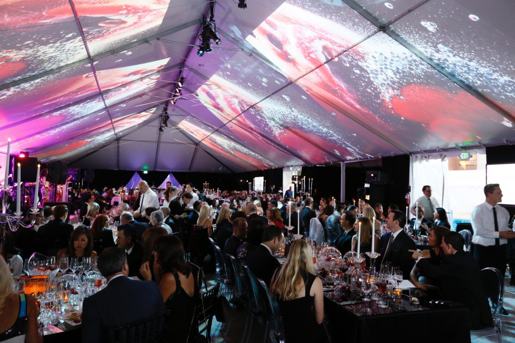 The 2016 Art of Dining honoring Marilyn Minter featured Minter;s artwork projected onto the ceiling of the gala tent (Photo by Ryan Miller/Capture Imaging)