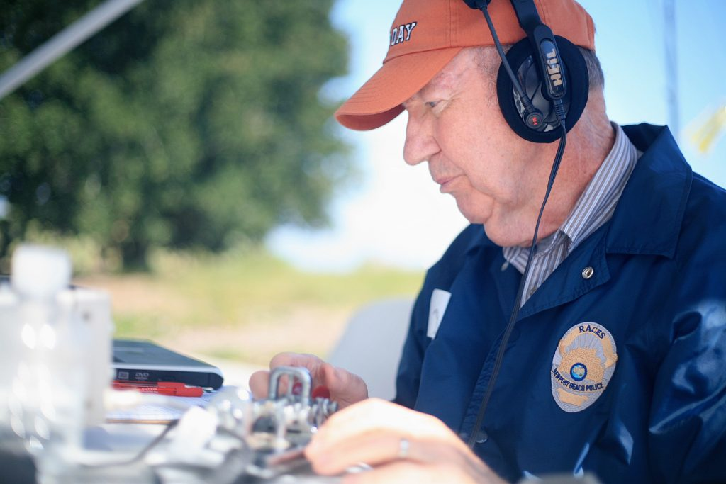 RACES member Bob Carlson sends a Morse code message during ARRL Field Day on Saturday. He had connected with the Belgium United Nations earlier in the day. — Photo by Sara Hall ©