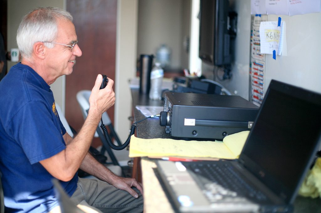 RACES member Bruce Moricca works the radio during the event on Saturday. — Photo by Sara Hall ©