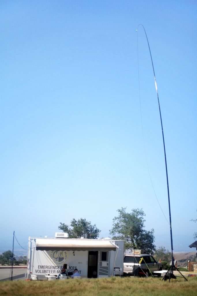 The Newport Beach RACES group set up the emergency services radio trailer and two tall wires in order to communicate with other radio operators around the world. — Photo by Sara Hall ©