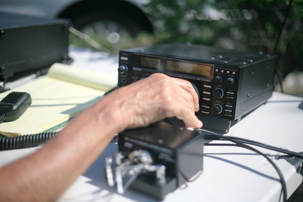 Roy Shlemon works his radio during the ARRL event on Saturday. — Photo by Sara Hall ©