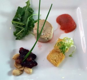Foie gras terrine with poached plum and brioche toast points
