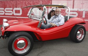 Russo and Steele owners Josephine and Drew Alcazar in a 1966 El Lobo dune buggy