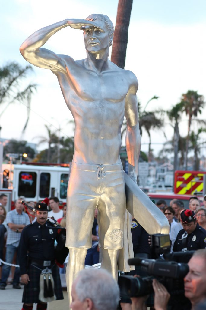 A statue of Ben Carlson, the first Newport Beach lifeguard to die in the line of duty, was unveiled on Wednesday night. — Photo by Jim Collins ©