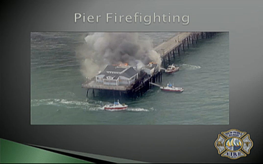The fire at the end of the Seal Beach pier prompted Newport Beach Fire Department officials to examine Newport and Balboa piers. — Screenshot from NBFD presentation