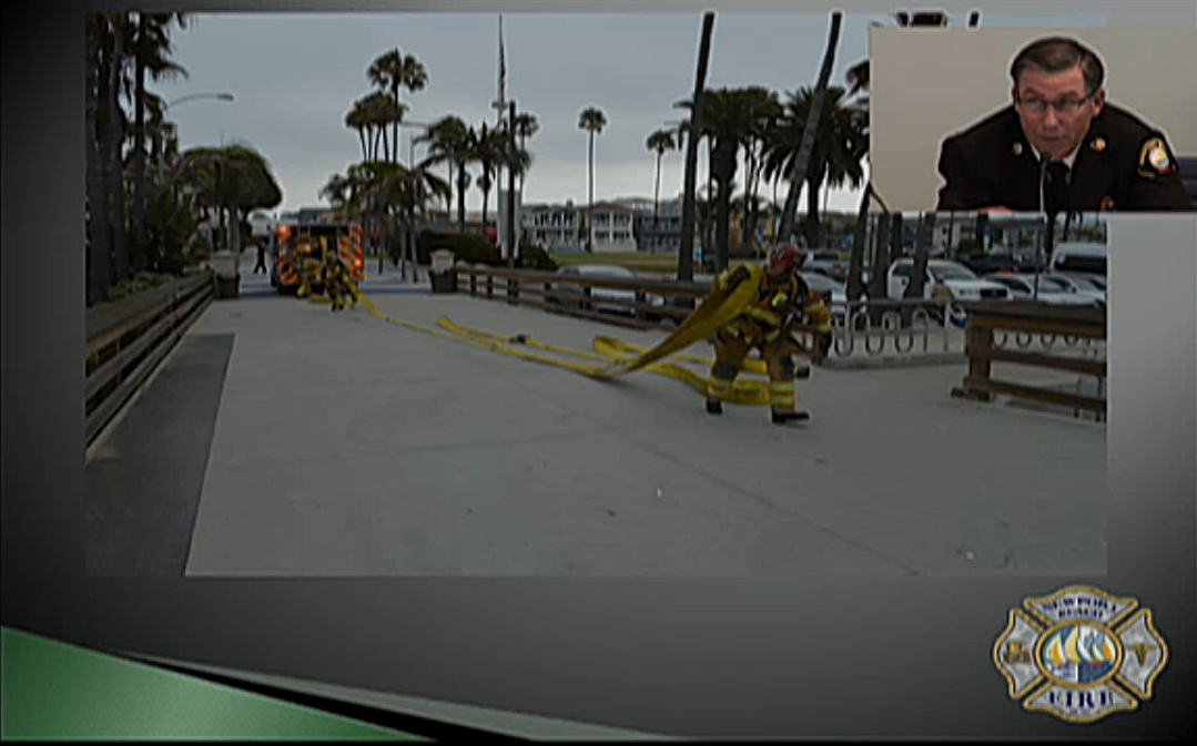 NBFD Assistant Chief Chip Duncan describes the simulation Newport firefighters conducted on the Balboa Pier recently during his presentation. — Screenshot from NBFD presentation