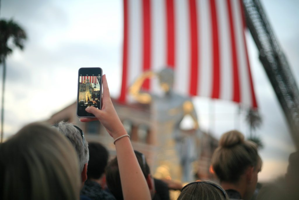 People take photos of the statue after the unveiling. — Photo by Sara Hall ©