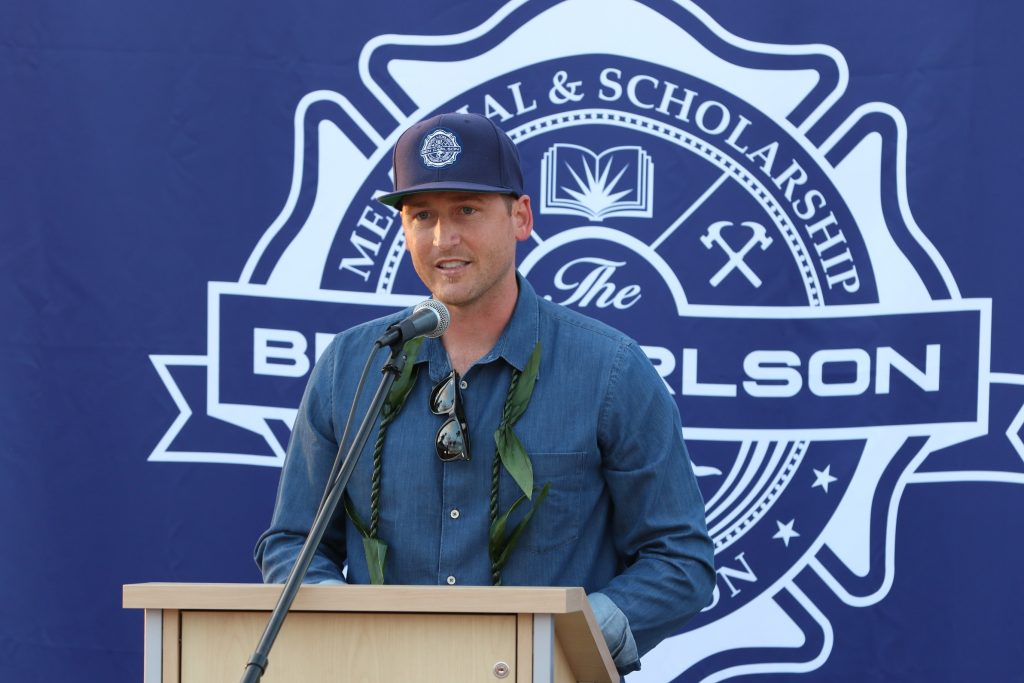 Ben Carlson's brother-in-law and statue artist, Jake Janz, speaks to the crowd on Wednesday. — Photo by Jim Collins ©