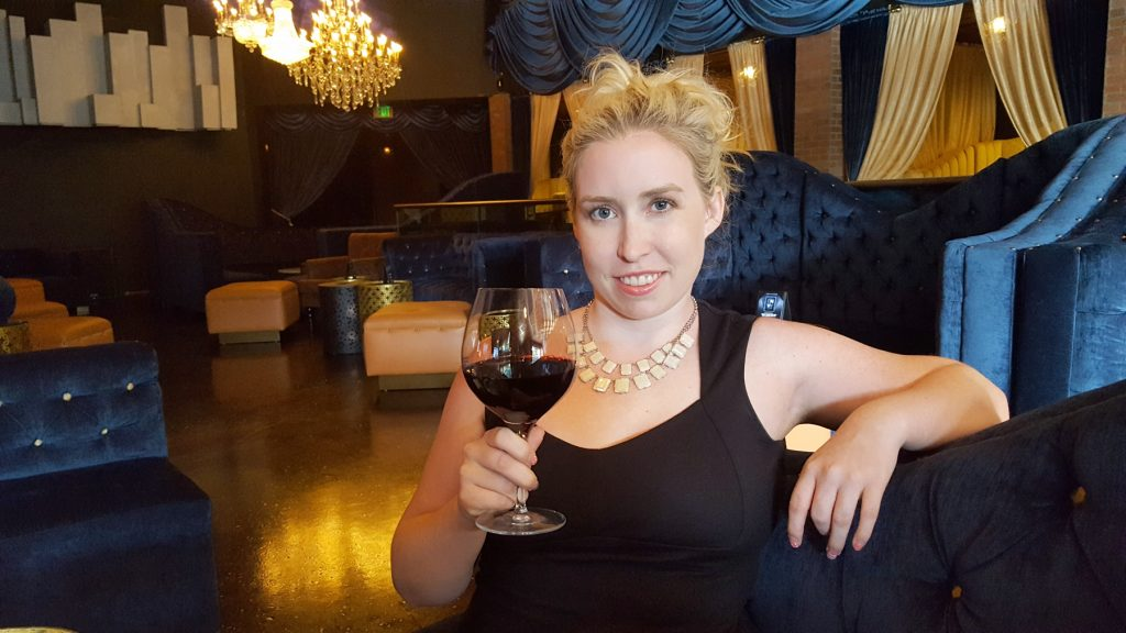 Catherine with a glass of The Prisoner