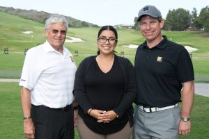 Gen. George Casey, Tatiana Rodriguez (veteran and now employee at the Tierney Center for Veteran Services), and Frank Talarico, Jr., Goodwill's CEO and president.