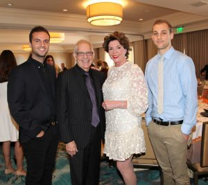 """Dodge College students and Women of Chapman endowment recipients Andrew Primavera, left, and Robert """"Robby"""" Bracker, right, with Dodge College Dean Bob Bassett and WOC Endowment Chair Adrienne Brandes"""