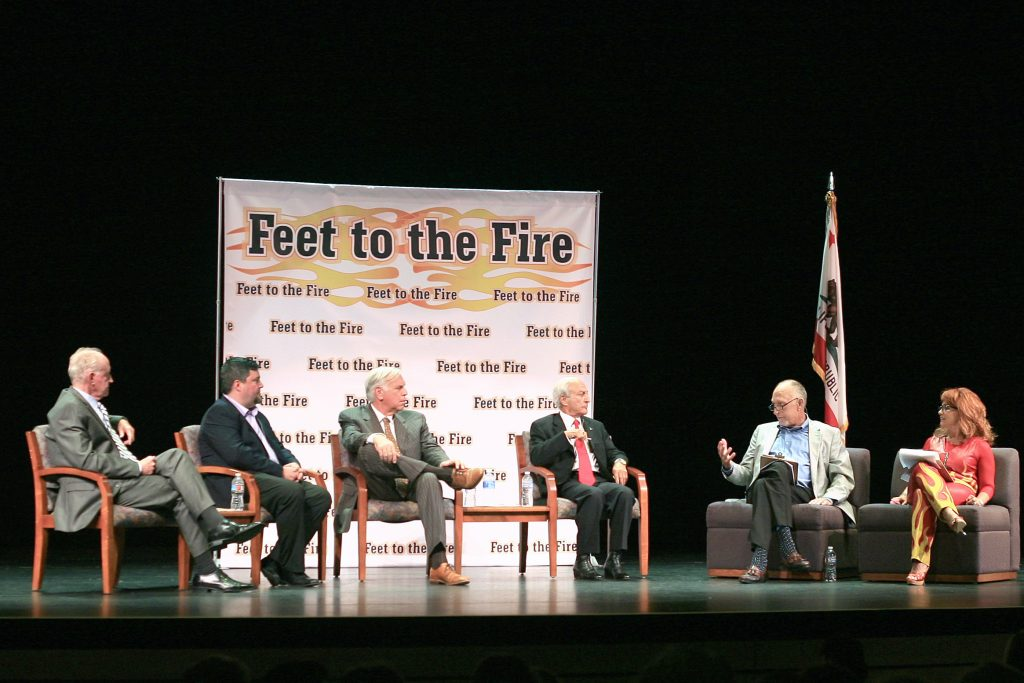 (left to right) Jeff Herdman and Mike Glenn for District 5; Phil Greer and Fred Ameri for District 7; and moderators Tom Johnson and Barbara Venezia, discuss Newport Beach topics at Feet to the Fire forum Wednesday. — Photo by Sara Hall ©