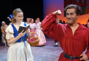 Gaston (Anthony Cervero) shows off for a disinterested Belle (Katherine Parrish) in the Summer Players production of Disney's Beauty and the Beast, August 12-14 on South Caost Repertory's Julianne Argyros Stage