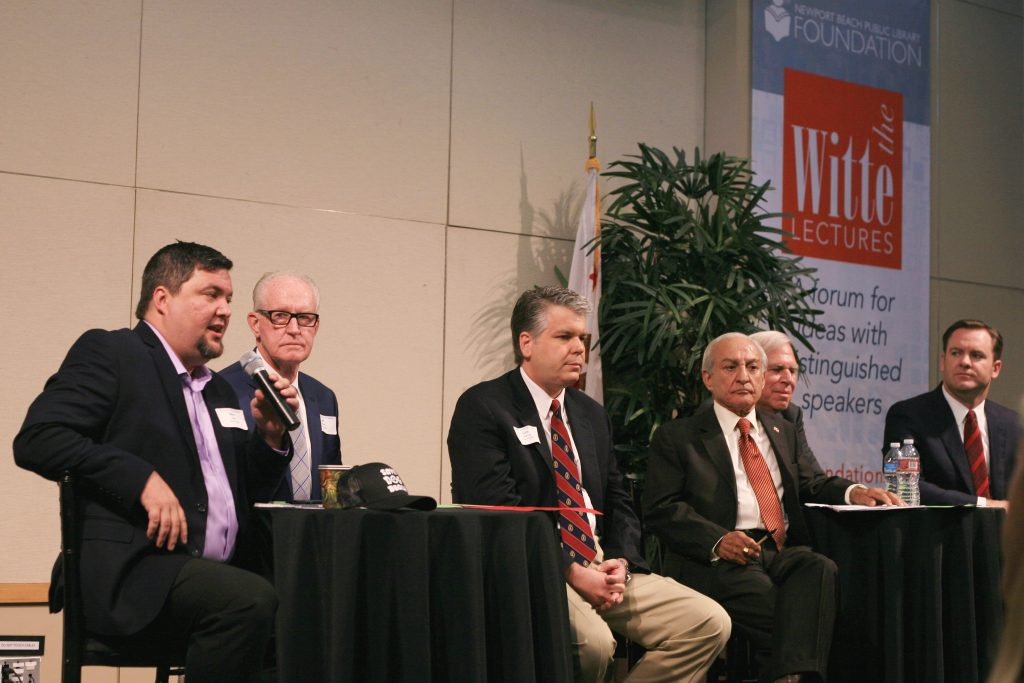 (left to right) Mike Glenn, Jeff Herdman, and Lee Lowrey for District 5; and Fred Ameri, Phil Greer, and Will O'Neill for District 7. Moderator Lucy Dunn. At the Newport Beach Chamber of Commerce hosted candidate forum Tuesday. (Brad Avery in District 2 is off camera to the left) — Photo by Sara Hall ©