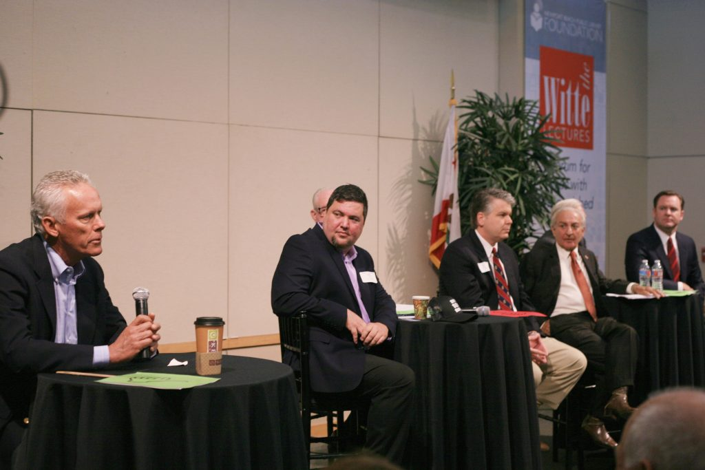 (left to right) Brad Avery in District 2 speaking as Mike Glenn, Jeff Herdman (hidden slightly in background), and Lee Lowrey for District 5; and Fred Ameri, Phil Greer (hidden slightly in background), and Will O'Neill for District 7 at the Newport Beach Chamber of Commerce hosted candidate forum Tuesday. — Photo by Sara Hall ©