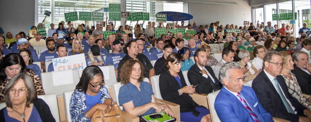 The crowd inside council chambers listens to the hearing on Banning Ranch on Wednesday. — Photo by Charles Weinberg ©