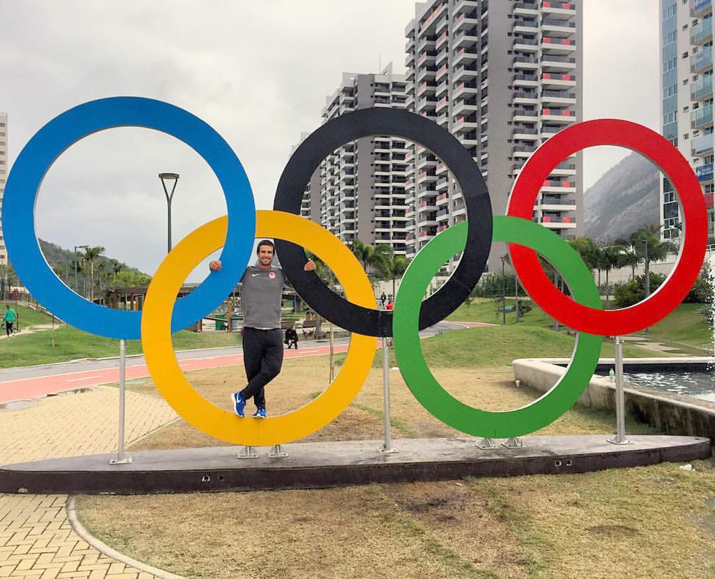 Charlie Buckingham, a member of the U.S. sailing team for the 2016 Olympics in Rio, poses for a photo with the Olympic rings.  — Photo courtesy of Charlie Buckingham ©