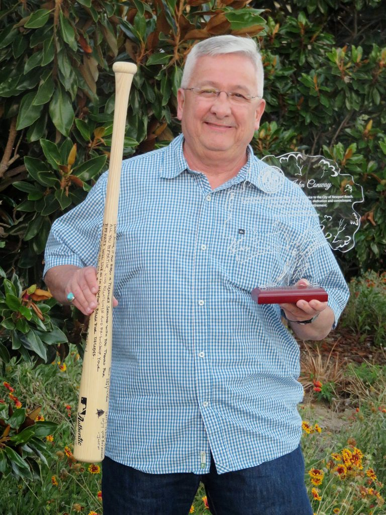 John Conway with his signed baseball bat from the recreation department and award for his service from the pubic works department. — Photo by Sara Hall ©
