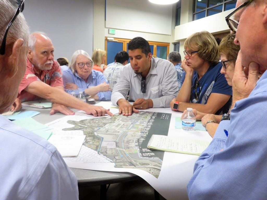 Jaime Murillo, a Newport Beach city senior planner, discusses the Mariners' Mile Revitalization Master Plan with members of the public during a special Planning Commission meeting and community workshop on Monday. — Photo by Sara Hall ©