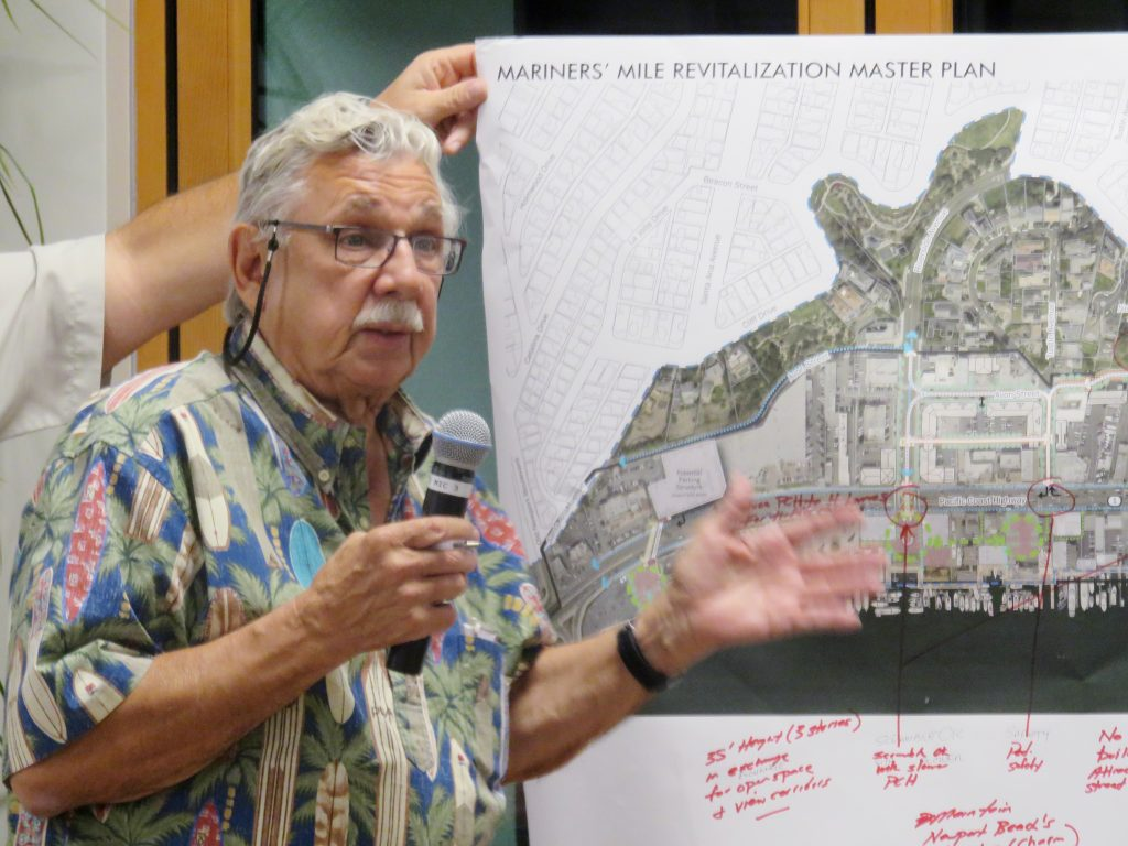 A member of the public talks about his group's ideas for the Mariners' Mile Revitalization Master Plan with in front of a map of the area during the meeting Monday. — Photo by Sara Hall ©