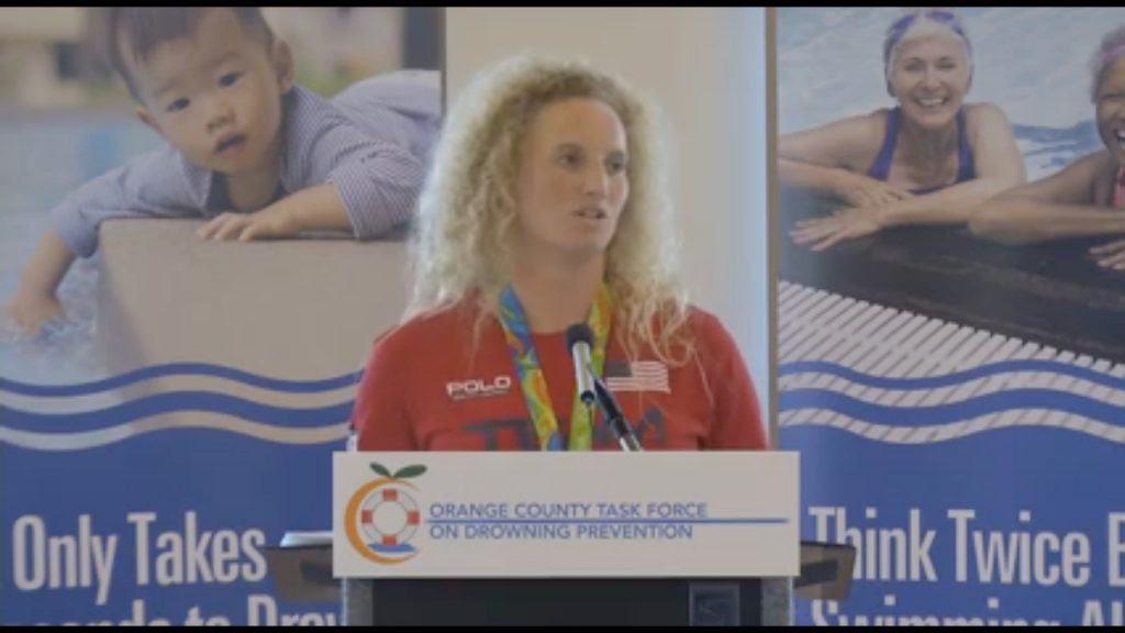 Newport Beach resident and 2016 Olympics Water Polo Gold Medalist Kaleigh Gilchrist talks about water safety at an Orange County Task Force on Drowning Prevention event on Wednesday. — Screen shot from Orange County Fire Authority video