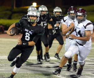 QB William Leong keeps the ball on a run for the Lightning
