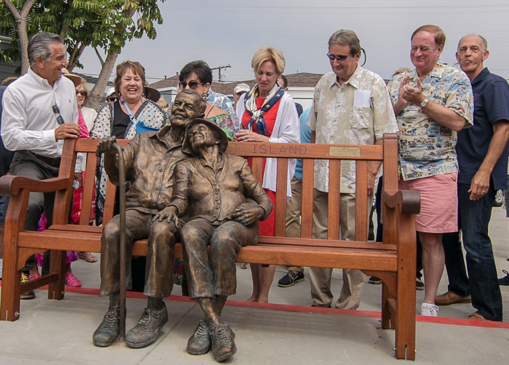 "(left to right) Councilman Tony Petros, sculptors Rhonda Jones and Miriam Baker, Mayor Diane Dixon, Councilmen Ed Selich and Keith Curry, and Balboa Island Improvement Association President Lee Pearl at the unveiling of the ""Sunset Years"" sculpture on Balboa Island. — Photo by Jim Collins ©"