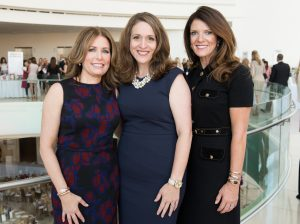 Harvesters Fashion Show & Luncheon co-chair and Newport Beach resident Susan Croul, CEO of Irvine-based Second Harvest Food Bank Nicole Suydam, and Harvesters Fashion Show & Luncheon chair and Newport Beach resident Melissa Knode
