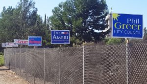 Newport Beach City Council Candidate signs attached to a fence along Bonita Canyon Drive near the 73 Toll Road