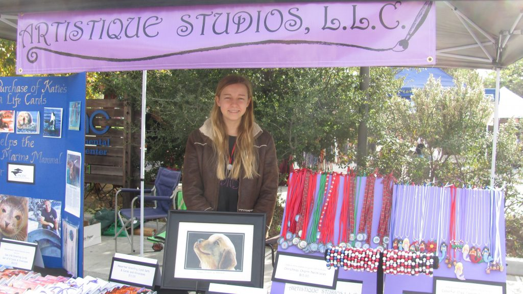 Katie Gerlt in the Artistique Studios craft fair booth. — Photo courtesy Artistique Studios, LLC ©