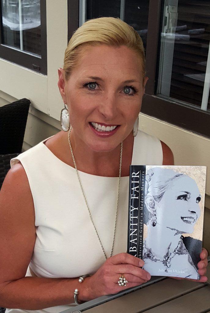 Julie Ann Ulcickas with her Urbanity Fair book — NB Indy file photo ©