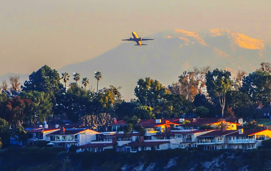 A plane taking off from John Wayne Airport over Newport Back Bay. — NB Indy file photo ©