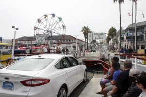 Tourists prepare to leave the Balboa Ferry for the Fun Zone