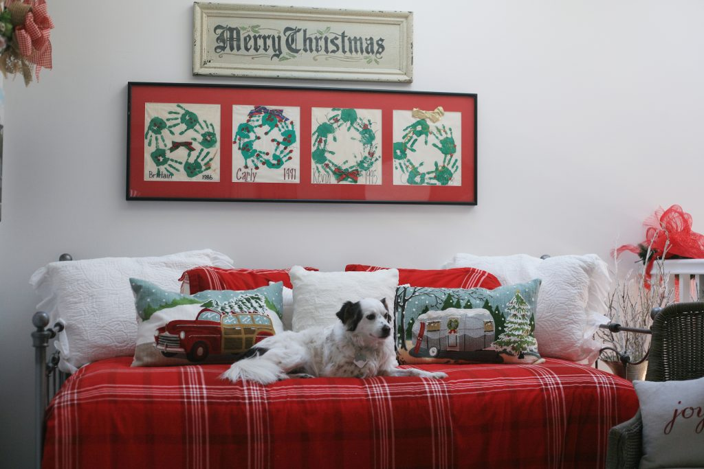 20th Annual Balboa Island Holiday Home Walking Tour homeowner participant Diana Conners' rescue dog Dewey relaxes on a decorated daybed in Conners S. Bayfront home. — Photo by Sara Hall ©