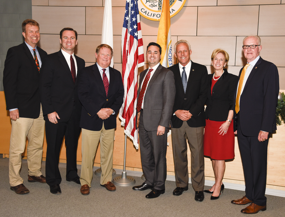 "The three new councilmen elected in November took office during the Dec. 13 City Council meeting and, along with the rest of the council, unanimously elected Kevin Muldoon as mayor and Marshall ""Duffy"" Duffield as mayor pro tem for 2017. The entire council (left to right) Scott Peotter, Will O'Neill, Mayor Pro Tem Marshall ""Duffy"" Duffield, Mayor Kevin Muldoon, Brad Avery, Diane Dixon, and Jeff Herdman. — Photo by Lawrence Sherwin ©"