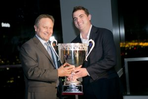 Chase Hoeven presenting The Kaprielian Cup to Commonwealth Partners' Brett Munger for the company's ongoing support. Photo by Carla Rhea