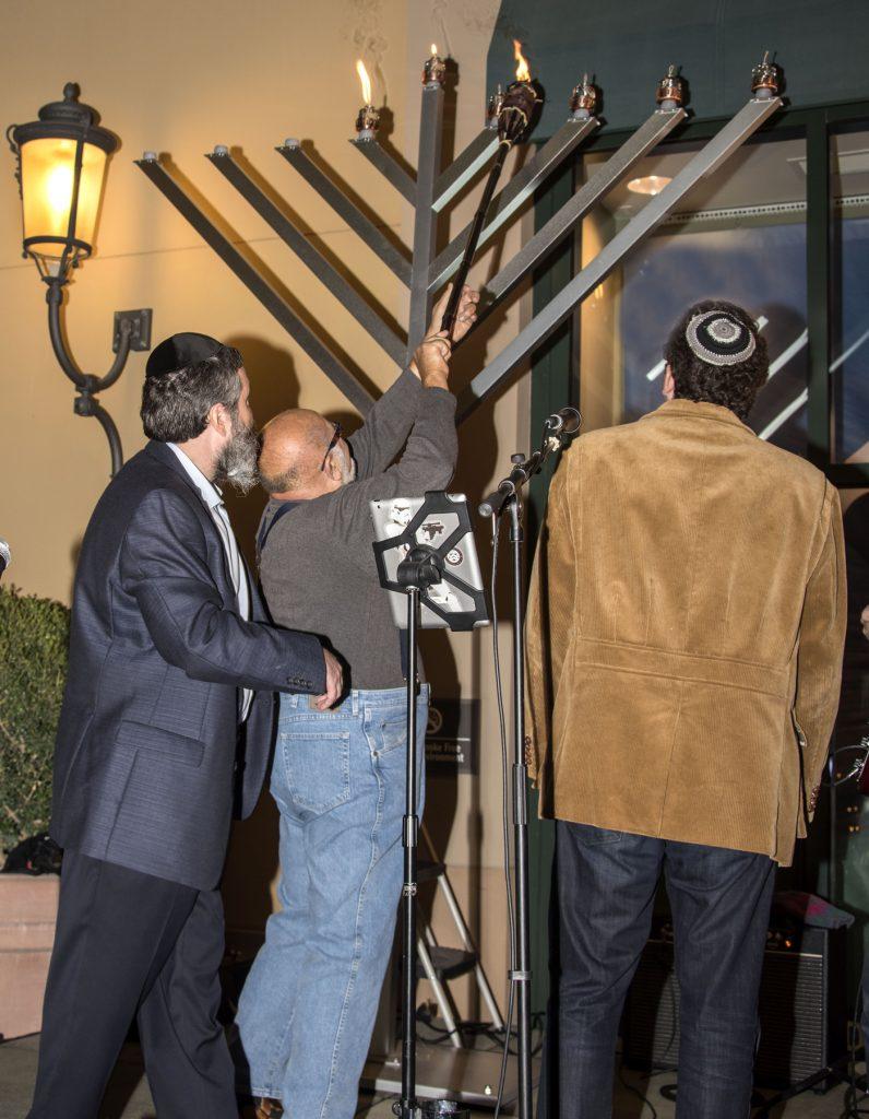 Rabbi Mintz and Sam Silberberg light the Menorah at Fashion Island. — Photo by Charles Weinberg ©