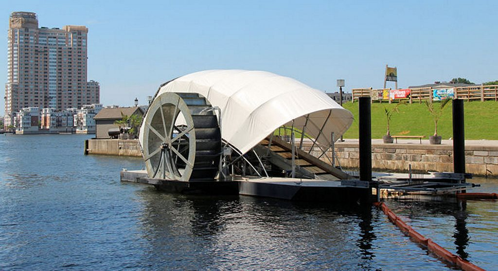 The solar-powered, debris-gathering water wheel in Baltimore, the same concept that is proposed for Newport Bay.  — Photo courtesy of Billy Dutton/Baltimore waterfront ©