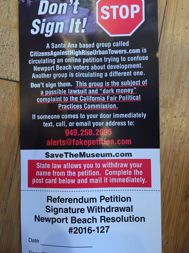 "A ""fake petition"" door hanger. — NB Indy file photo ©"