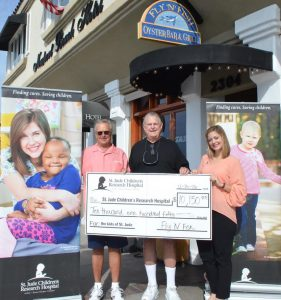 Fly-n-Fish owners Steve & Rick Loomis with Shannon O'Nale of St. Jude Children's Research Hospital