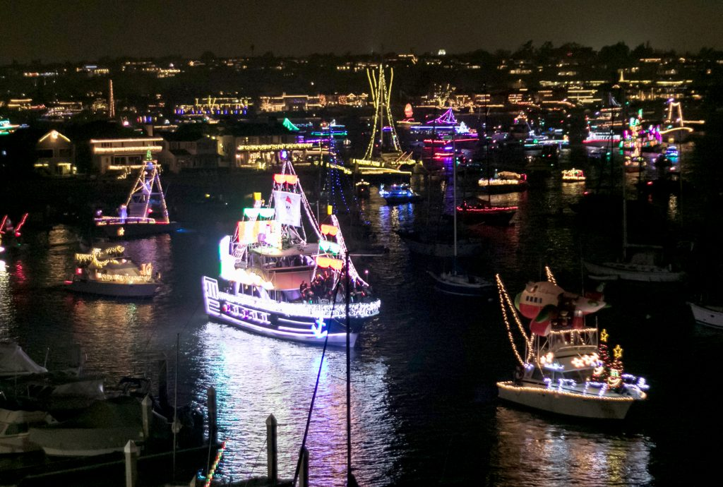 Boats parading in Newport Harbor / Photo by Jim Collins
