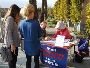 Residents line up in front of the Newport Beach Public Library to sign the Line in the Sand petition against Museum House.