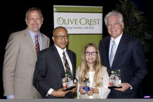 (left to right) Donald Verleur, Olive Crest CEO, Gary Taylor, Orange County Director of Children & Family Services, Grace Cross, an Outstanding Girl Scout and Role Model, and Dennis Kuhl, Chairman Angels Baseball.