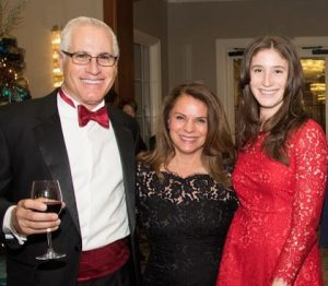 UCI MIND Co-Director, Dr. Frank LaFerla toasts UCI MIND Leadership Council member, Dr. Jacqueline DuPont and his daughter, Monica LaFerla.
