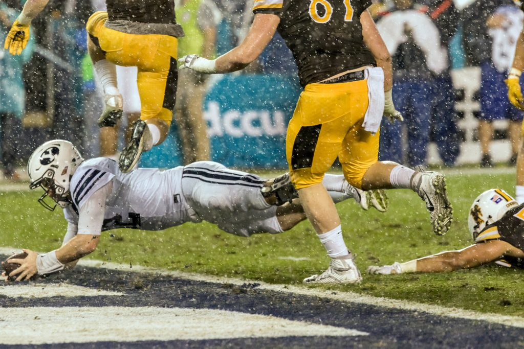 BYU Quarterback Tanner Mangum dives into end zone for the first score of the game