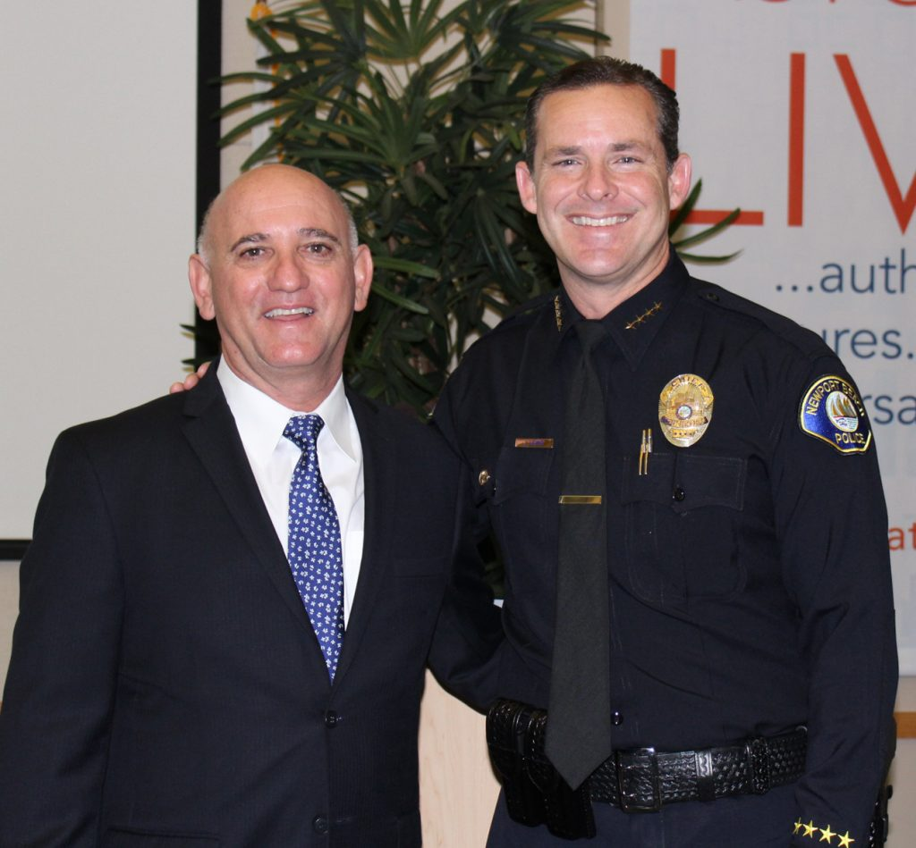 Chamber of Commerce President Steve Rosansky and Chief of Police Jon Lewis pose for a photo at the Chamber's monthly Wake Up! Newport meeting on Thursday. — Photo by Victoria Kertz ©