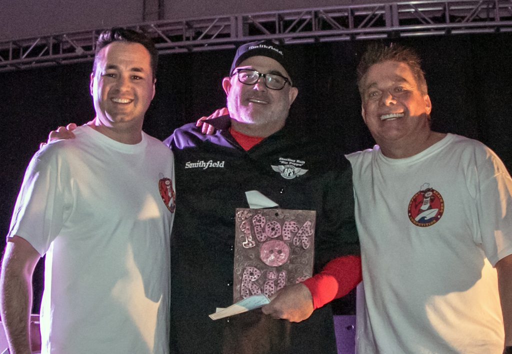 Mayor Kevin Muldoon, grand prize winner Sterling Ball of Big Poppa Smokers, Winter Q founder Steve Bender (photo by Jim Collins)
