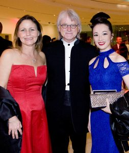 (left to right) Susan St. Clair, Music Director of the Pacific Symphony Carl St. Clair, and YaYa Zhang, Producer and Choreographer of Chinese New Year Celebration.