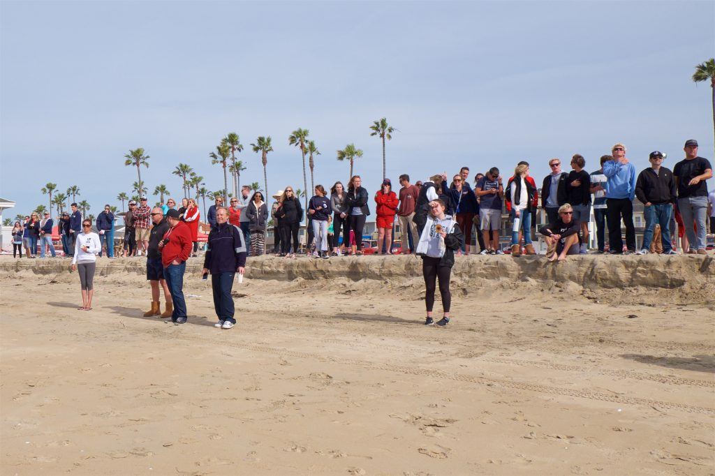 People watch the race from the sidelines on the beach. — Photo by Jim Collins ©